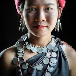 Portrait on a Kayah woman with traditional attire in her house, Loikaw area, Myanmar, Asia