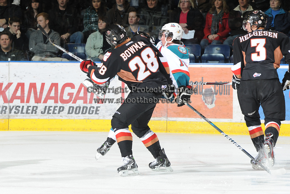 KELOWNA, CANADA, FEBRUARY 17: Collin Bowman #28 of the Calgary Hitmen checks Shane McColgan #18 of the Kelowna Rockets at the Kelowna Rockets on February 17, 2012 at Prospera Place in Kelowna, British Columbia, Canada (Photo by Marissa Baecker/Shoot the Breeze) *** Local Caption ***