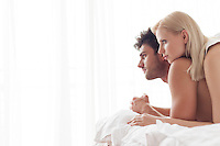 Thoughtful young couple in bed