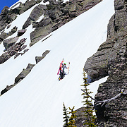 Lynsey Dyer hiking up for her next turns in Glacier National Park.