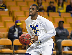 Nov 16, 2015; Charleston, WV, USA; West Virginia Mountaineers forward Elijah Macon warms up before their game against the James Madison Dukes at the Charleston Civic Center. Mandatory Credit: Ben Queen-USA TODAY Sports