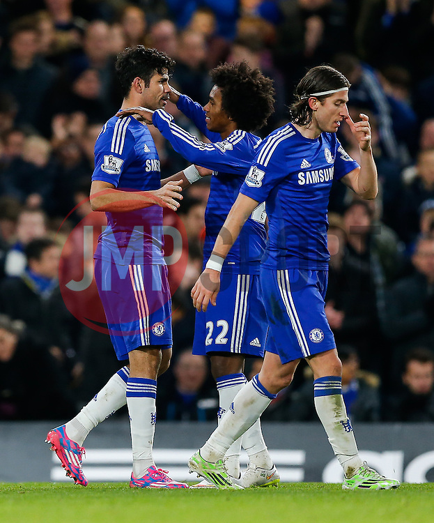 Diego Costa of Chelsea celebrates with Willian after scoring a goal to make it 2-0 - Photo mandatory by-line: Rogan Thomson/JMP - 07966 386802 - 13/12/2014 - SPORT - FOOTBALL - London, England - Stamford Bridge - Chelsea v Hull City - Barclays Premier League.