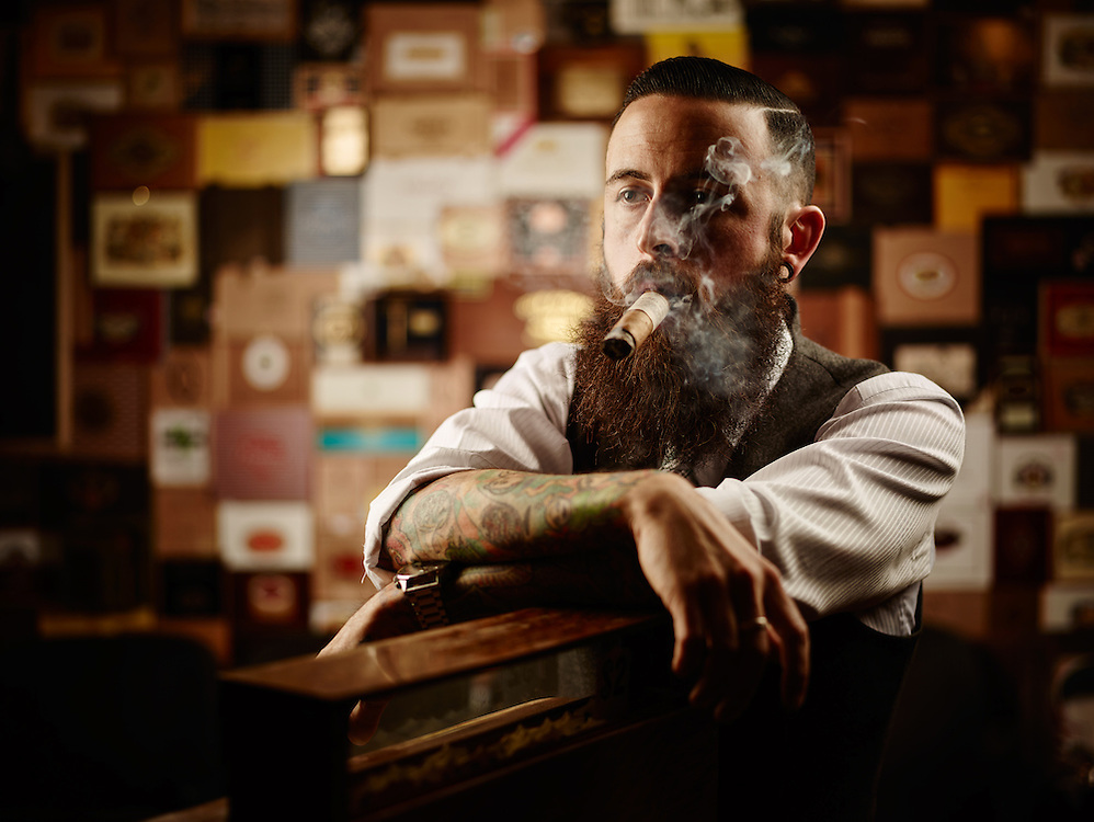 Man smoking a Cigar in his cigar and barber shop Shot on a PhaseOne IQ180 as a Environmental Portrait.