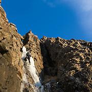 """Freyr Inga Björnssyni climbing """"Nálaraugað"""" WI4 Búahamrar, Esja."""