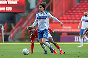 Rochdale defender Jordan Williams (8) dribbling past Charlton Athletic midfielder Joe Aribo (17) during the EFL Sky Bet League 1 match between Charlton Athletic and Rochdale at The Valley, London, England on 4 May 2019.