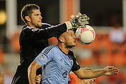 Oct 9, 2013; Houston, TX, USA; Houston Dynamo goalkeeper Tally Hall (1) blocks a shot against Sporting KC defender Aurelien Collin (78) during the second half at BBVA Compass Stadium. The game ended in a 0-0 draw. Mandatory Credit: Thomas Campbell-USA TODAY Sports