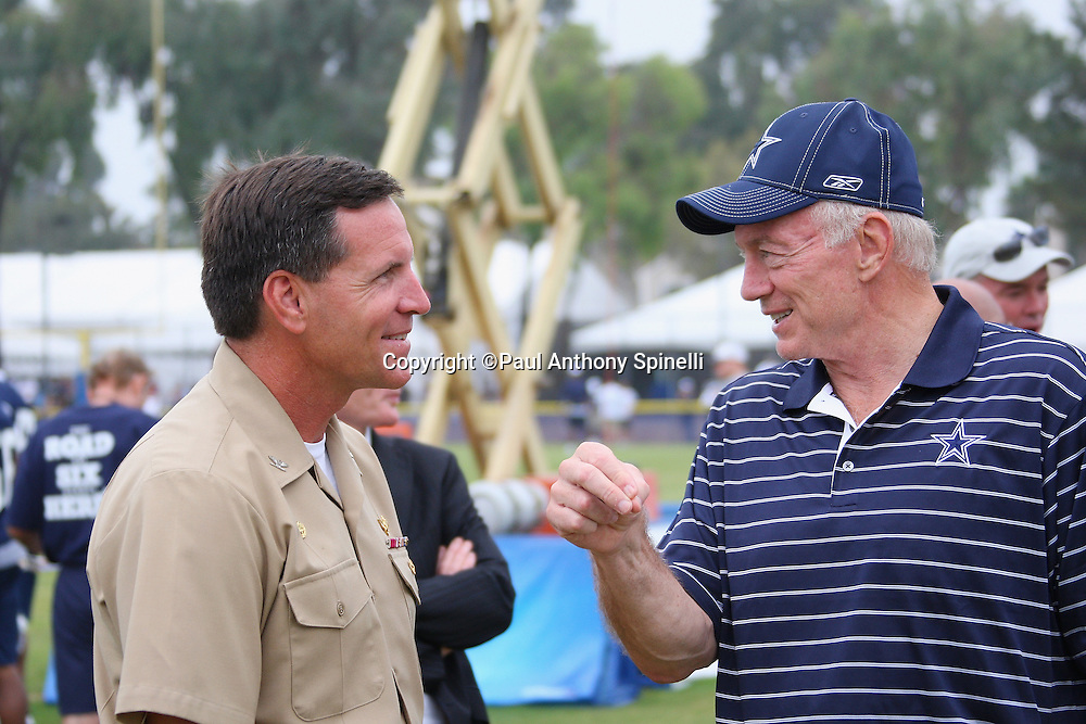"""OXNARD, CA - AUGUST 01:  Team Owner, President and General Manager Jerry Jones (right) of the Dallas Cowboys talks to Captain Brad """"Brick"""" Conners, the Commanding Officer of the Naval Base Ventura County, during the 2008 Dallas Cowboys Training Camp at River Ridge Field in Oxnard, California on August 1, 2008. ©Paul Anthony Spinelli *** Local Caption *** Jerry Jones;Brad Conners"""