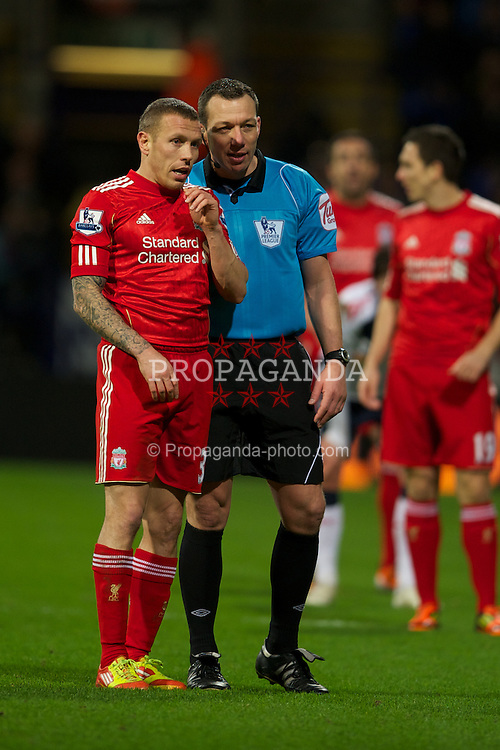 BOLTON, ENGLAND - Saturday, January 21, 2011: Liverpool's Craig Bellamy has words with referee Kevin Friend during the Premiership match against Bolton Wanderers at the Reebok Stadium. (Pic by David Rawcliffe/Propaganda)