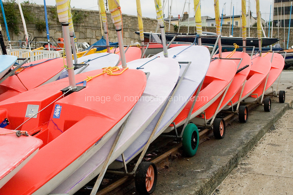 Laser sailing boats in boat yard at Dun Laoghaire Harbour in Dublin Ireland