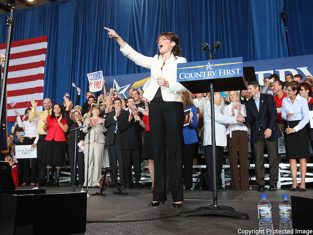 U.S. Republican vice presidential nominee Governor Sarah Palin points to a person in the crowd at a campaign rally in Cedar Rapids, Iowa, September 18, 2008.