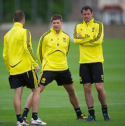 LIVERPOOL, ENGLAND - Wednesday, September 15, 2010: Liverpool's captain Steven Gerrard MBE and Jamie Carragher during a training session at Melwood Training Ground ahead of the opening UEFA Europa League Group K match against FC Steaua Bucuresti. (Photo by David Rawcliffe/Propaganda)
