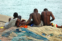 GHANA,Accra,Jamestown, 2007. Fishermen in Jamestown relax before setting out into the Atlantic for a full day shift.