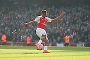 Arsenal forward, Alex Iwobi (45) with shot on goal during the The FA Cup Quarter Final match between Arsenal and Watford at the Emirates Stadium, London, England on 13 March 2016. Photo by Matthew Redman.