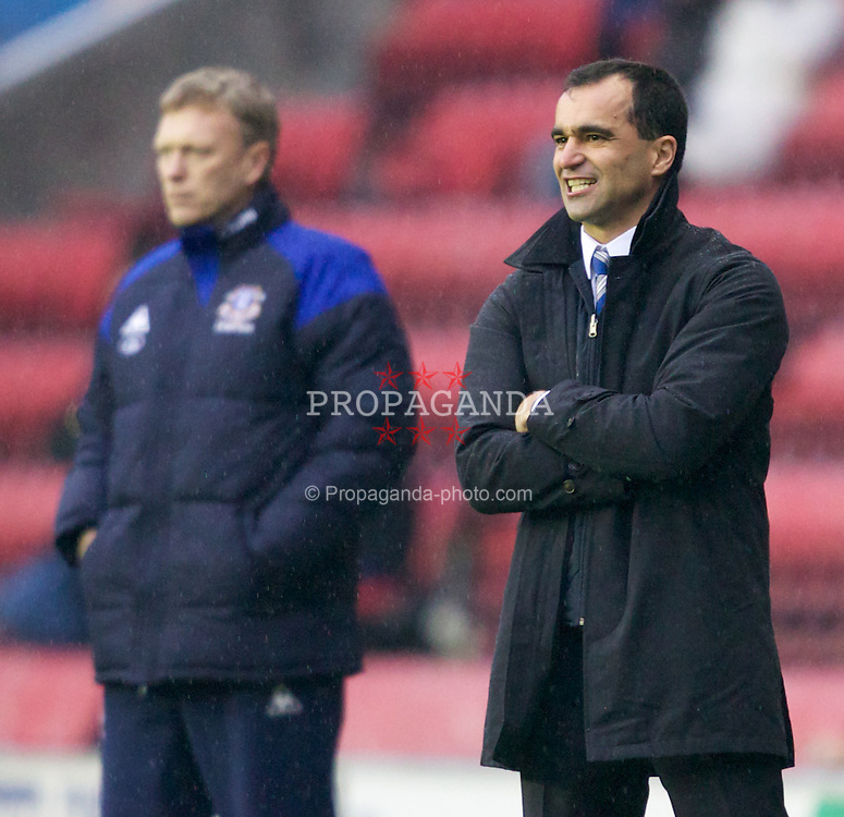 WIGAN, ENGLAND - Saturday, February 4, 2012: Wigan Athletic's manager Roberto Martinez and Everton's manager David Moyes during the Premiership match at the DW Stadium. (Pic by Vegard Grott/Propaganda)