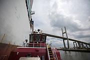 The crew aboard the Cooper Moran tug escorts the 13,000 TEU OOCL Korea up river to Port of Savannah at the Georgia Ports Authority Garden City Terminal, Thursday, Aug., 3, 2017, in Savannah, Ga.  (GPA Photo/Stephen B. Morton)