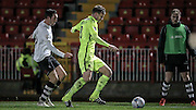 Andy Wright (Southport) goes to clear the ball in the dying seconds of the game. Kicking it to row z to waste a few more seconds during the Vanarama National League match between Gateshead and Southport at Gateshead International Stadium, Gateshead, United Kingdom on 8 December 2015. Photo by Mark P Doherty.