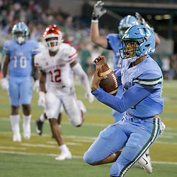 Sep 19, 2019; New Orleans, LA, USA; Tulane Green Wave quarterback Justin McMillan (12) runs for a touchdown against the Houston Cougars during the fourth quarter at Yulman Stadium. Mandatory Credit: Derick E. Hingle-USA TODAY Sports