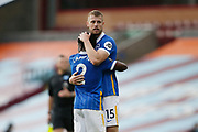 Brighton and Hove Albion defender Tariq Lamptey (2) and Brighton and Hove Albion defender Adam Webster (15) celebrate at full time during the Premier League match between Burnley and Brighton and Hove Albion at Turf Moor, Burnley, England on 26 July 2020.