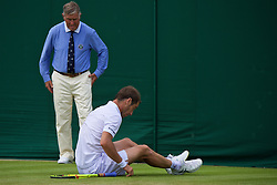 LONDON, ENGLAND - Tuesday, June 28, 2016: Richard Gasquet (FRA) slips and falls onto his back during the Gentlemen's Singles 1st Round match on day two of the Wimbledon Lawn Tennis Championships at the All England Lawn Tennis and Croquet Club. (Pic by Kirsten Holst/Propaganda)