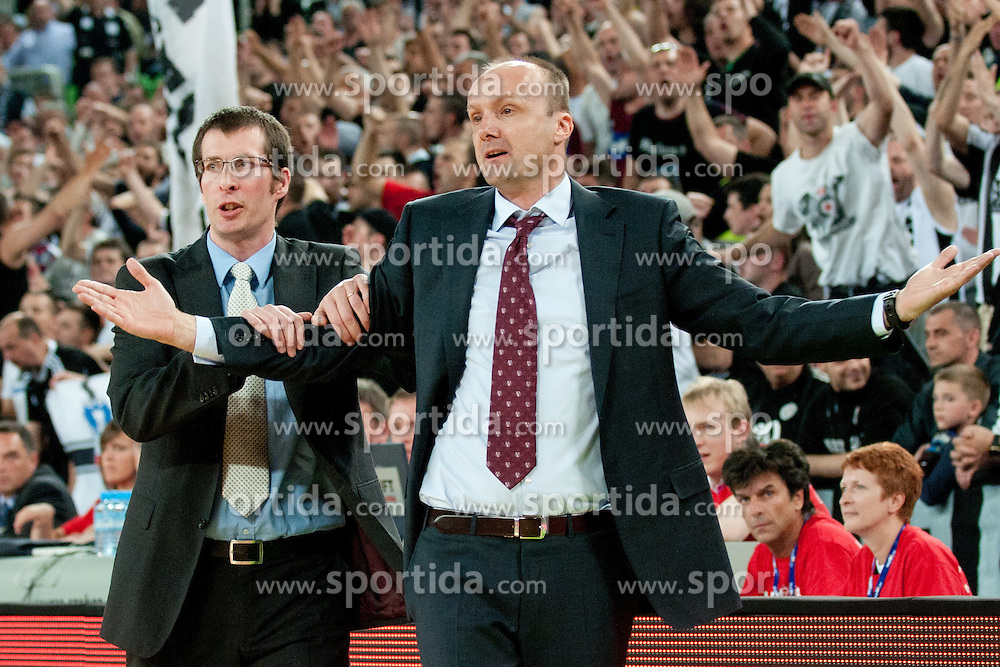 Jaka Daneu (assistant coach) calming down Jure Zdovc (head coach of Union Olimpija) during final match of Basketball NLB League at Final Four tournament between KK Union Olimpija (SLO) and Partizan Belgrade (SRB), on April 21, 2011 at SRC Stozice, Ljubljana, Slovenia. (Photo By Matic Klansek Velej / Sportida.com)