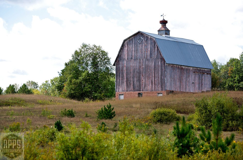 A collection of Barns that still can be seen while traveling the countryside in  the beautiful State of Wisconsin.<br /> Barn- Douglas County-Gray Gambrel roof barn with metal Cupala. County Road E &amp; County Road L. Barns from around the State of Wisconsin.