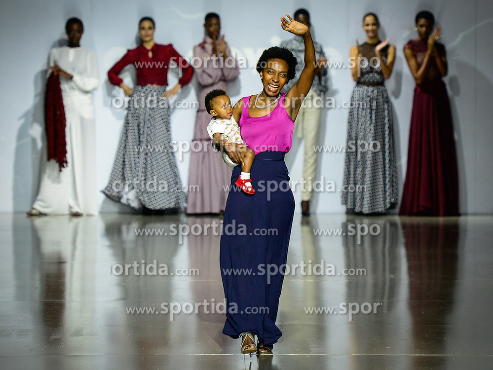 Local designer Khomotjo Malatji of Grapevine greets the audience with her child after presentation of her creations on the third day of Mercedes-Benz Fashion Week Joburg 2016 at Nelson Mandela Square in Johannesburg, South Africa on March 12, 2016. The Mercedes-Benz Fashion Week Joburg 2016, the largest and leading one in Africa, closed here Saturday. Creations by nearly 20 South African fashion designers have been presented in 14 shows of the past three days. EXPA Pictures © 2016, PhotoCredit: EXPA/ Photoshot/ Zhai Jianlan<br /> <br /> *****ATTENTION - for AUT, SLO, CRO, SRB, BIH, MAZ, SUI only*****