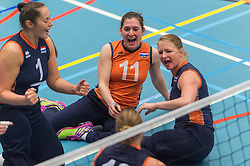 14-02-2016 NED: Nederland - Oekraine, Houten<br /> De Nederlandse paravolleybalsters speelde een vriendschappelijke wedstrijd tegen Europees kampioen Oekra&iuml;ne. De equipe van bondscoach Pim Scherpenzeel bereidt zich tegen Oekra&iuml;ne voor op het Paralympisch kwalificatietoernooi in China, dat in maart wordt gespeeld / Elvira Stinissen #1 of Nederland, Judith Jacobs #11 of Nederland, Paula List #8 of Nederland