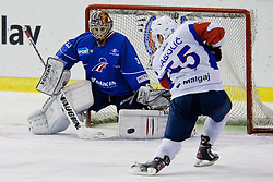 Robert Sabolic of Slovenia vs goalie Ronan Quemener of France during ice-hockey match between Slovenia and France in Slovenia Euro ice hockey challenge, on December 17, 2011 at Hala Tivoli, Ljubljana, Slovenia. France defeated Slovenia 6:5 after penalty shots. (Photo By Matic Klansek Velej / Sportida)