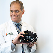 MIAMI, FLORIDA, DECMBER 7, 2018<br /> Michael E. Hoffer, M.D., FACS, from the University ion Miami's Miller School of Medicine, holds a pair of concussion goggles which was used in the medical examination of dozens of United States Havana Embassy after complaints of auditive complications. Claims of ultrasonic waves aimed at the embassy staff were investigated by Hoffer and his staff.<br /> (Photo by Angel Valentin/Freelance)