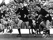 Murray Taylor 79-80 gets his pass away in the tackle of an Australian. Others here are Kieran Crowley 85-87, 90-91 and Wayne Smith 80, 82-85. New Zealand All Blacks v Australia, year unknown. Photo: PHOTOSPORT/Peter Bush