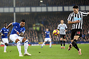 Everton striker Theo Walcott (11) and Newcastle United defender Federico Fernandez (18) during the Premier League match between Everton and Newcastle United at Goodison Park, Liverpool, England on 5 December 2018.