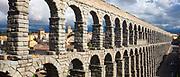 Famous spectacular Roman aqueduct, built of granite blocks, by Plaza del Azoguejo, Segovia, Spain