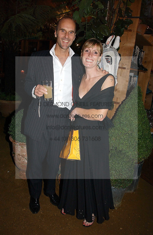 SKYE GYNGELL and JAMES HENDERSON at a party to celebrate the publication on 'A Year in My Kitchen' by Skye Gyngell held at The Petersham Nurseries, Petesham, Surrey on 19th October 2006.<br /><br />NON EXCLUSIVE - WORLD RIGHTS
