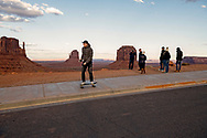 Monument Valley Tribal Park, West Mitten, East Mitten, Merricks Butte, Monument Valley, Arizona, tourist, teenagers