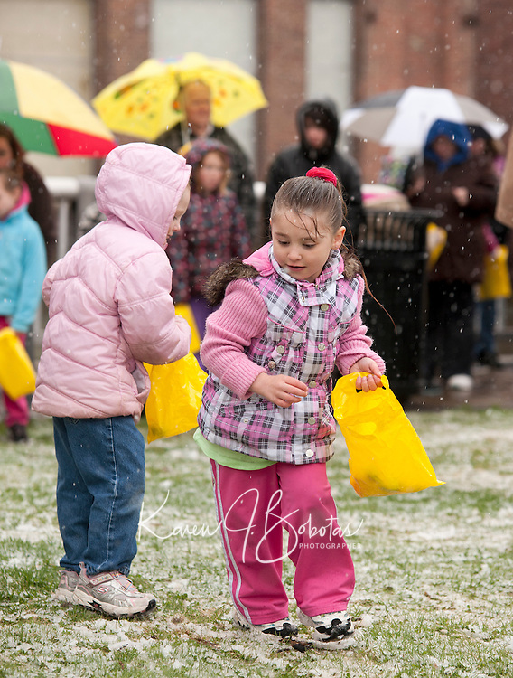 Aliyah Hollins and Savannah Shaw find plenty of eggs on the snow covered lawn at Laconia Rotary Park Saturday afternoon during the Easter Eggstravaganza event.  (Karen Bobotas/for the Laconia Daily Sun)Downtown Laconia's Easter Eggstravaganza event Saturday April 23, 2011.