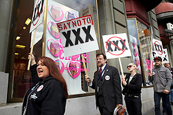 Members of The Free Speech Coalition, representing the adult industry, protest against the proposed .XXX top-level domain outside the ICANN 40 meetings in San Francisco.  Protestors say the change will cost website operators millions in unnecessary fees and make porn sites easier to block by governments.