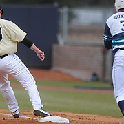 Wake Forest's Aaron Fossas tags UNCW's Terence Connelly out at first base Sunday February 22, 2015 during the Hughes Brothers Challenge at Brooks Field. (Jason A. Frizzelle)