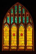 Stained glass windows at night at Wai'oli Hui'ia Church, Hanalei, Island of Kauai, Hawaii USA