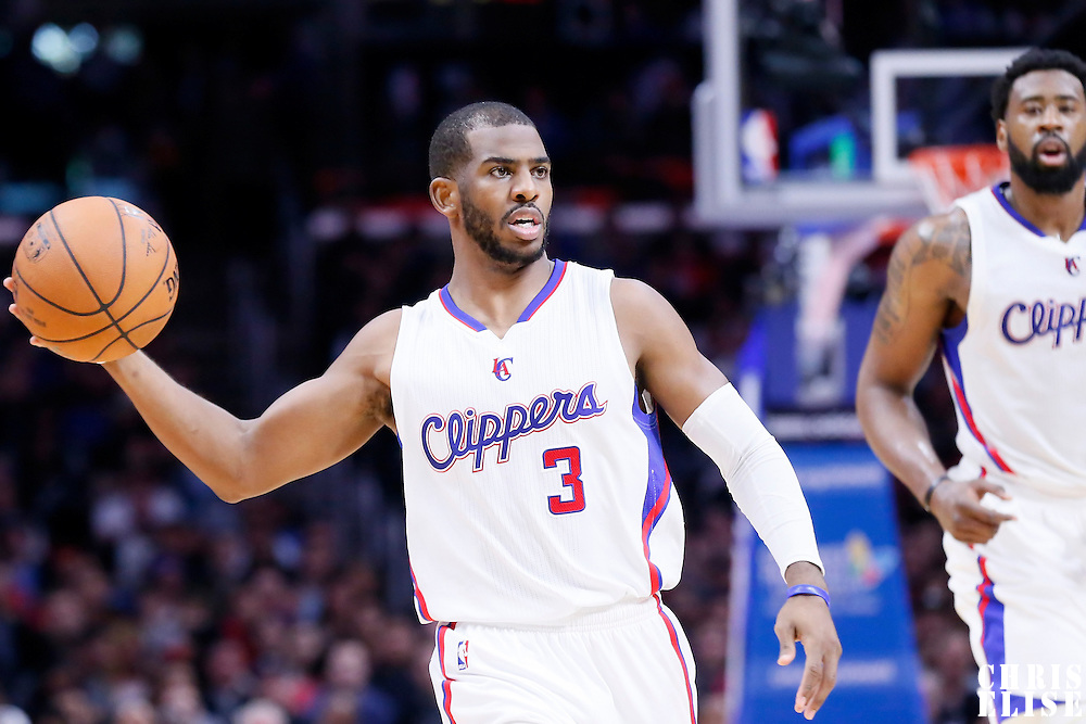 10 January 2014: Los Angeles Clippers guard Chris Paul (3) passes the ball during the Los Angeles Clippers 120-100 victory over the Dallas Mavericks, at the Staples Center, Los Angeles, California, USA.