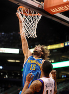Nov. 23, 2012; Phoenix, AZ, USA; New Orleans Hornets center Robin Lopez (15) dunks the ball during the game against the Phoenix Suns forward Markieff Morris (11) in the first half at US Airways Center. The Suns defeated the Hornets 111-108 in overtime. Mandatory Credit: Jennifer Stewart-US PRESSWIRE..