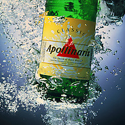 Bottle of Apollinaris rising from underwater with bubbles Ray Massey is an established, award winning, UK professional  photographer, shooting creative advertising and editorial images from his stunning studio in a converted church in Camden Town, London NW1. Ray Massey specialises in drinks and liquids, still life and hands, product, gymnastics, special effects (sfx) and location photography. He is particularly known for dynamic high speed action shots of pours, bubbles, splashes and explosions in beers, champagnes, sodas, cocktails and beverages of all descriptions, as well as perfumes, paint, ink, water – even ice! Ray Massey works throughout the world with advertising agencies, designers, design groups, PR companies and directly with clients. He regularly manages the entire creative process, including post-production composition, manipulation and retouching, working with his team of retouchers to produce final images ready for publication.