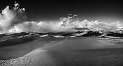 Storm clouds gather over the dunes of Great Sand Dunes National Park in southern Colorado.