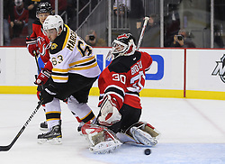 Jan 4, 2012; Newark, NJ, USA; New Jersey Devils goalie Martin Brodeur (30) makes a save through a screen by Boston Bruins left wing Brad Marchand (63) during the first period at the Prudential Center.