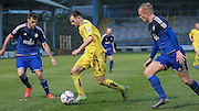 Will Hatfield (Guiseley) runs between two Halifax defenders during the Conference Premier League match between FC Halifax Town and Guiseley at the Shay, Halifax, United Kingdom on 5 December 2015. Photo by Mark P Doherty.