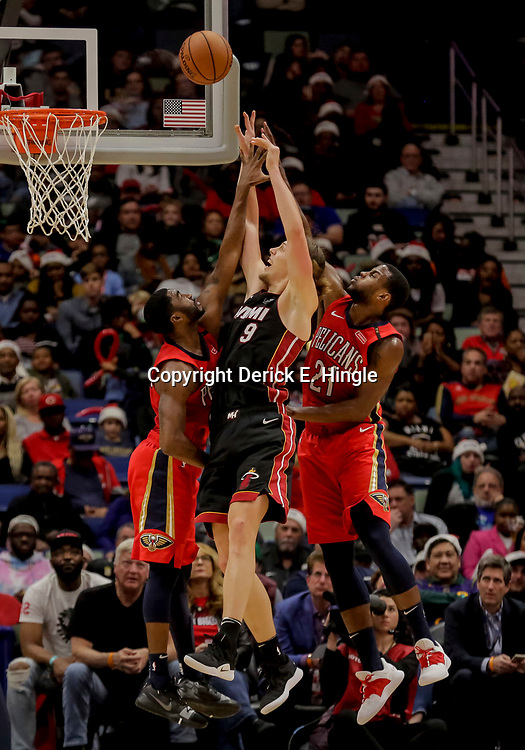 Dec 16, 2018; New Orleans, LA, USA; Miami Heat forward Kelly Olynyk (9) shoots over New Orleans Pelicans guard E'Twaun Moore (55) and forward Darius Miller (21) during the second half at the Smoothie King Center. Mandatory Credit: Derick E. Hingle-USA TODAY Sports