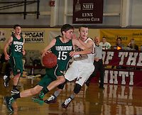Hopkinton's Liam McNicholas dribbles around Concord's Kaleb Marquis during semi final action in the Capitol Area Holiday Tournament at NHTI Saturday evening.  (Karen Bobotas/for the Concord Monitor)