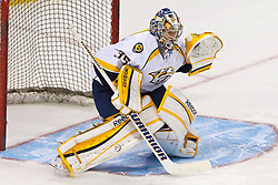 Mar 15, 2012; San Jose, CA, USA; Nashville Predators goalie Pekka Rinne (35) warms up before the game against the San Jose Sharks at HP Pavilion. San Jose defeated Nashville 2-1 in shootouts. Mandatory Credit: Jason O. Watson-US PRESSWIRE