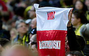 Supporters of Dortmund with flag of Jakub Blaszczykowski during the UEFA Champions League Final football match between Borussia Dortmund and Bayern Munich at Wembley Stadium in London on May 25, 2013...England, London, May 25, 2013..Picture also available in RAW (NEF) or TIFF format on special request...For editorial use only. Any commercial or promotional use requires permission...Photo by © Adam Nurkiewicz / Mediasport