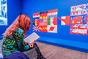 Album the Red 1968-70 by Gerard Formanger - The EY Exhibition: The World Goes Pop, opens at the Tate Modern. The exhibition covers the full breadth of international Pop Art from the 1960s and 70s, 'exploding' the traditional story of Pop. The show features 'colourful and exciting' works from Latin America, Asia, Europe and the Middle East – the majority of which have never before been shown in the UK. Highlights include: Japanese pop artist Tajiri's striking large scale sculpture Machine No.7, surrounded by works by artists Ushio Shinohara, Erro, Equipo Cronica and Evelyne Axel; a mirrored full room installation specially recreated for this exhibition by Polish pop artist Jana Zelibska; and Henri Cueco's multi-layered sculptural work Large Protest 1969 seen in front of his painting The Red Men, bas-relief 1969, exploring the Cold War, Vietnam War and May 1968 protests in Paris. The Exhibition is at Tate Modern from 7 September 2015 - 24 January 2015.