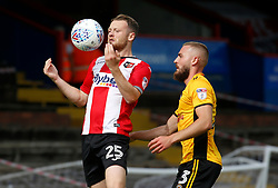 Exeter City's Jake Taylor and Newport County's Dan Butler (right) battle for the ball during the Sky Bet League Two match at St James Park, Exeter.